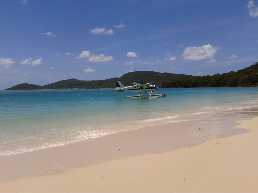 Whitehaven Beach op Whitsunday Island met watervliegtuig