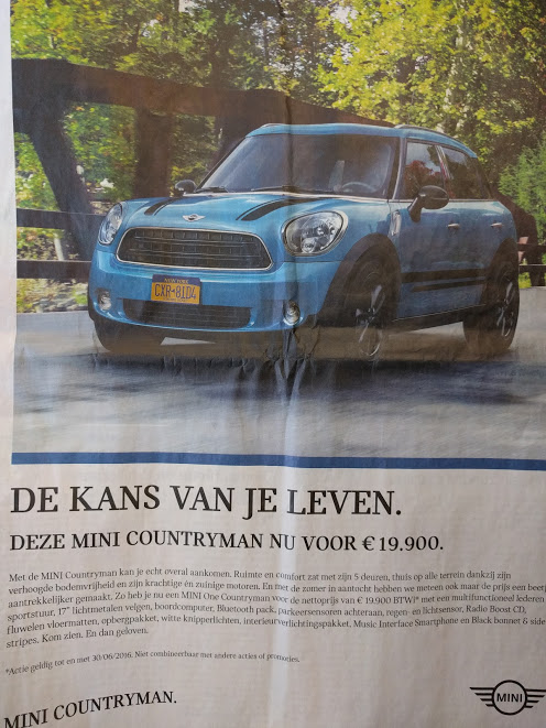Mini Cooper in Vlaamse krant met nummerplaat uit NYC