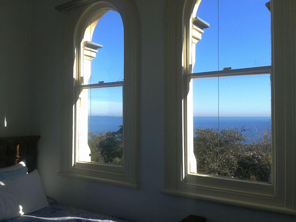 slaapkamer met zicht op zee in Mornington, Melbourne, Australië