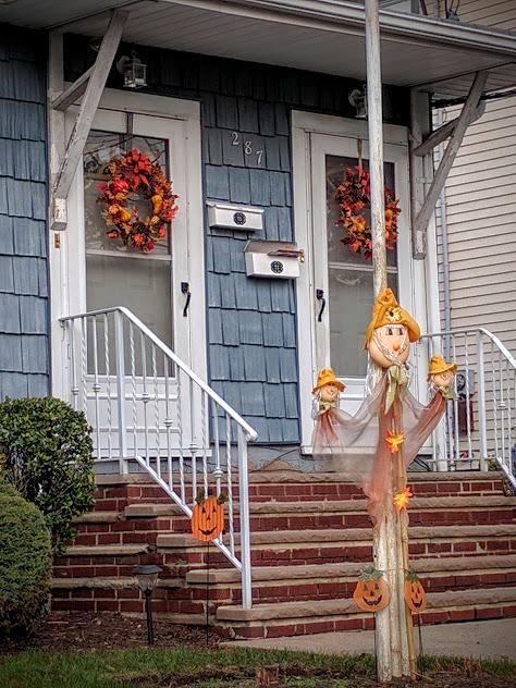 herfstversiering aan de voordeur