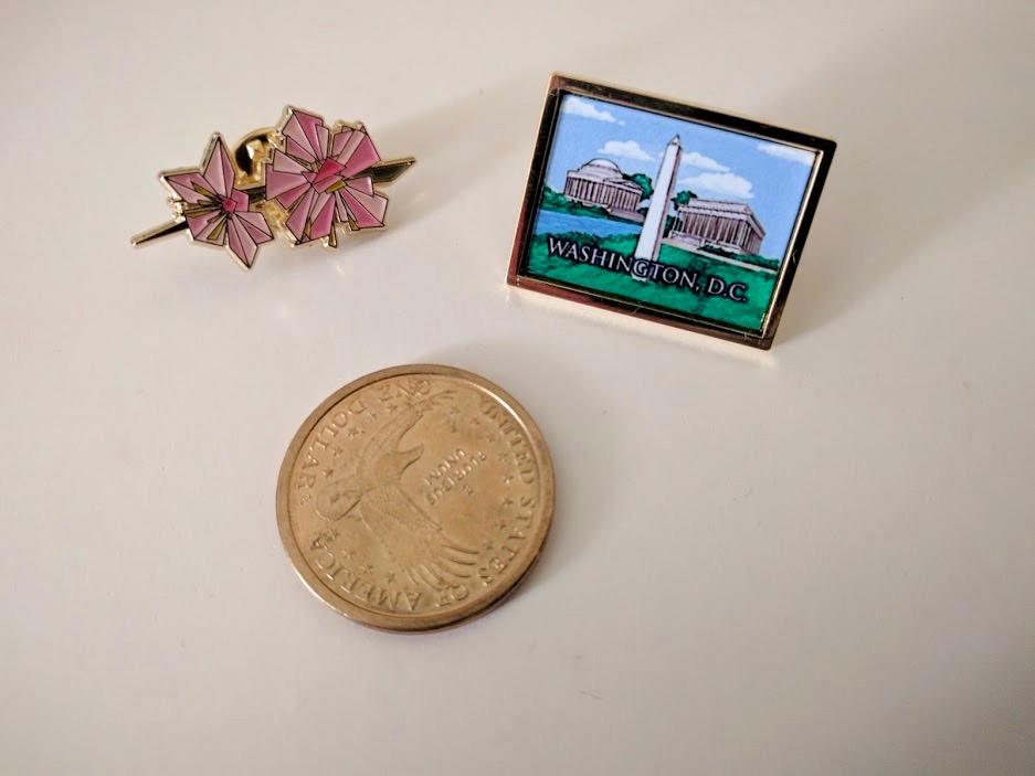 $1-munt en pins van Washington DC