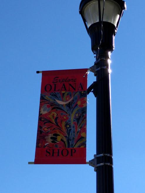 vlag aan lantaarn met Olana schilderij